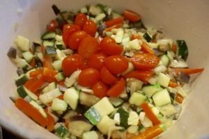 Add the tomatoes and cook with the other vegetables for 10 minutes